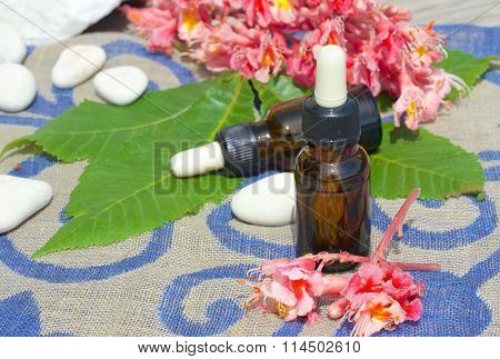 A dropper bottle of chestnut blossoms extract on a sackcloth