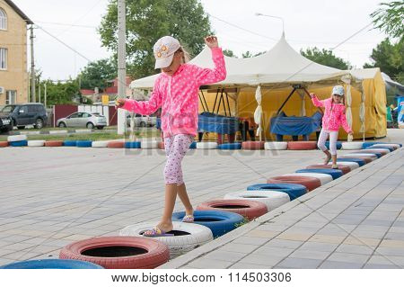 Two Girls Walking With Interest On Tires Protecting Circuit