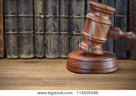 Wooden Judges Jydjes Gavel And Old Law Books On Wooden Background
