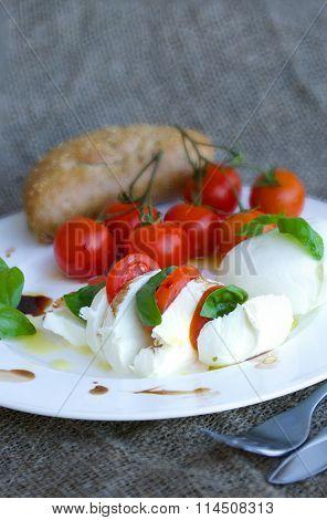 Buffalo Mozzarella With Cherry Tomatoes On A Twig