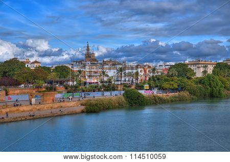 The skyline of the city of Seville with the Canal de Alfonso xiii in HDR