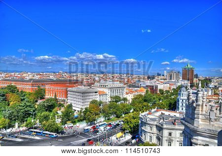 The skyline of Madrid as can be seen from Cybele Palace at Plaza de Cibeles on a sunny day in HDR
