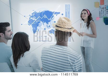 Global business interface against businesswoman giving presenting in front of group