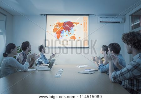 Futuristic interface with the world map against attentive business team applausing after a conference