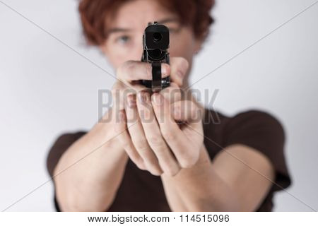 Woman with gun on a white background.