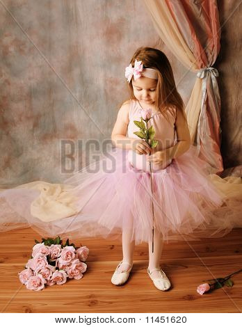 Little Ballerina Beauty Holding A Pink Rose