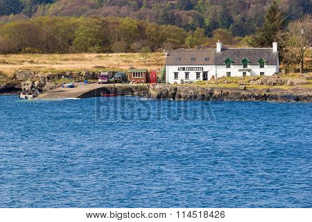 Little boathouse restaurant near edge of water on the west coast of Mull at the island of Ulva