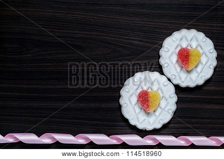 Background With A Flowers From Gingerbread With Icing And Jujube Heart-shaped