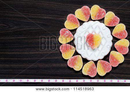 Background With A Flower From Gingerbread With Icing And Jujube Heart-shaped