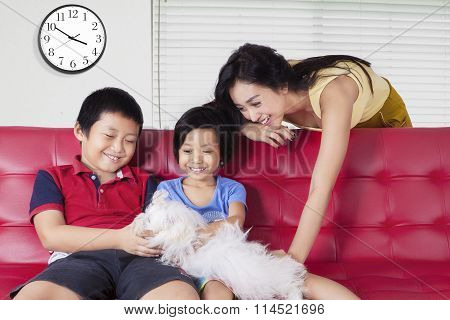 Children And Mother Playing Dog