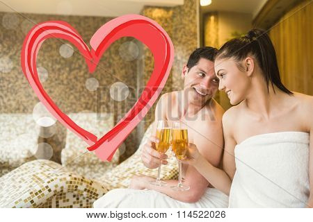 Couple relaxing in the thermal suite against heart