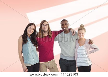 Portrait of smiling business team with arms around against red vignette