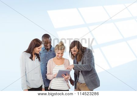 Happy woman holding digital tablet and discussing with coworkers against blue vignette background