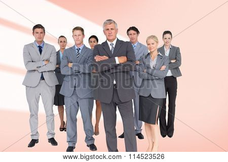 Business team standing arms crossed against red vignette