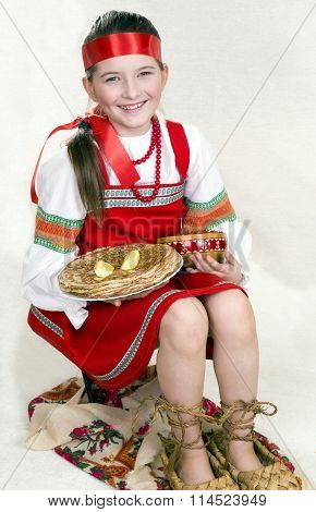 Russian girl national clothes and the big bast shoes