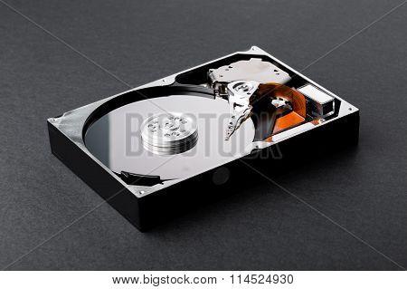 Open Disassembled Hard Disk On Black Plastic Background