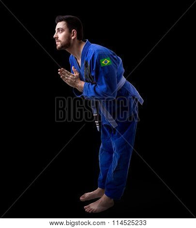Brazilian judoka fighter man on black background