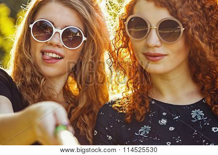 Two Girls Making Fun Selfie.