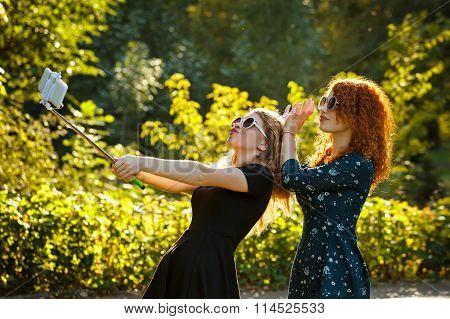 Two Girls In Sunglasses Do Selfie.