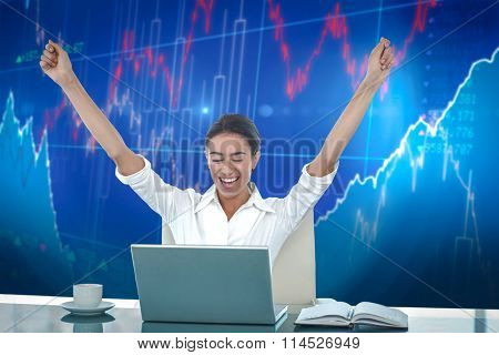 Businesswoman celebrating a great success against stocks and shares
