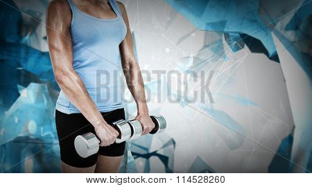 Muscular woman exercising with dumbbells against angular design