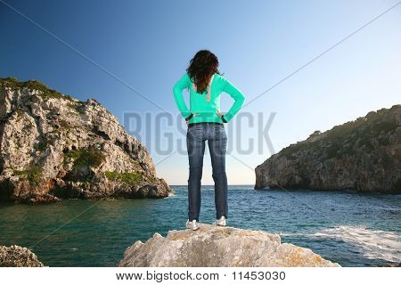 Jeans Woman Between Two Cliffs