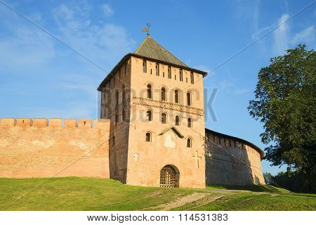 The Vladimir tower in the rays of the rising sun. The Kremlin Of Veliky Novgorod, Russia