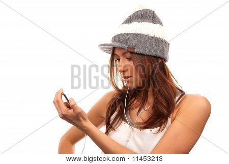 Female Lookin At Cell Phone In Headphones