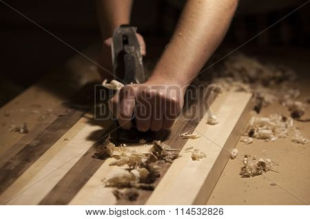 Man working wood with plane