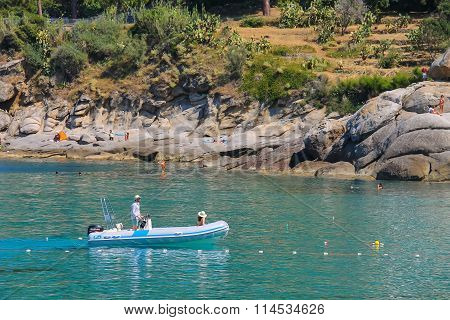 St Andreas Italy - July 01 2015: People sailing on motorboat in waters of Tyrrhenian Sea Sant Andreas on Elba Island Italy