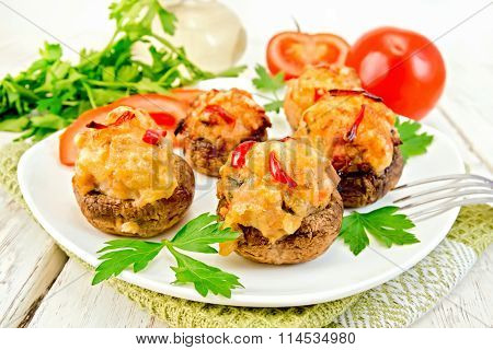 Champignons Stuffed Meat And Pepper In White Plate On Board