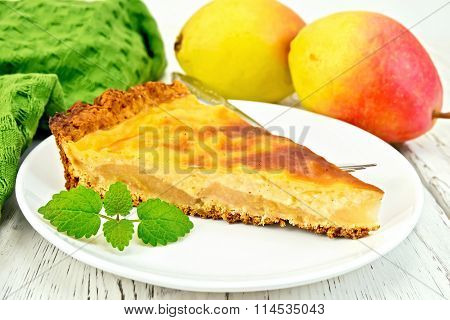 Pie pear with sour cream on light board