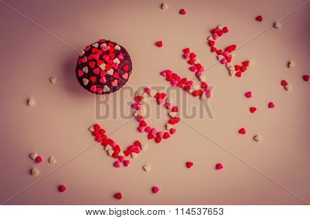 Cupcakes And Word Love With Small Hearts.