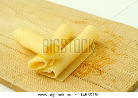Sliced delicious edam cheese on wooden board