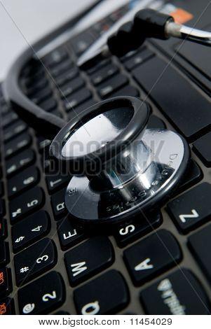 black stethoscope and keyboard
