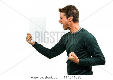 Angry man holding document while standing on white background