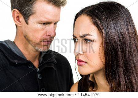 Couple not talking after argument on white background