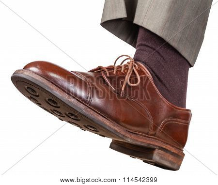 Male Left Foot In Brown Shoe Takes A Step