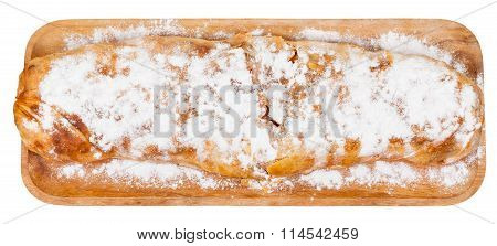 Top View Of Whole Apple Strudel On Wooden Board