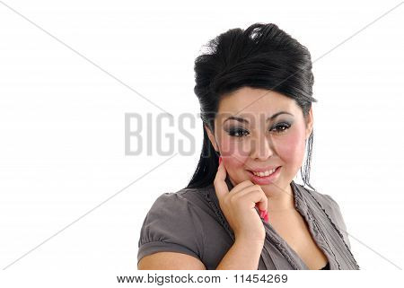 Woman With Her Finger To Her Cheek