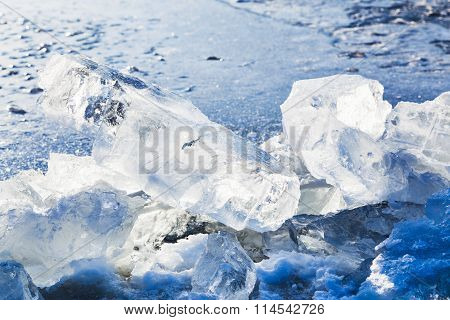 Ice Blocks On The Edge Of Ice-hole In Frozen Lake