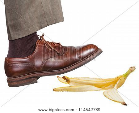 Leg In The Right Brown Shoe Slips On A Banana Peel