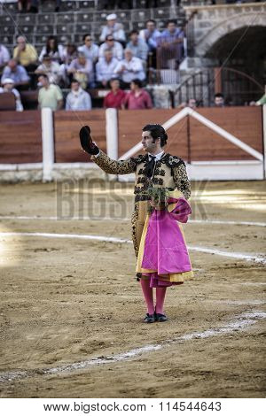 Spainish bullfighter Morante de la Puebla with montera in right hand and left hand rosemary thanking