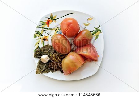 Pickled Tomatoes With Leaves Of Currant On A Plate
