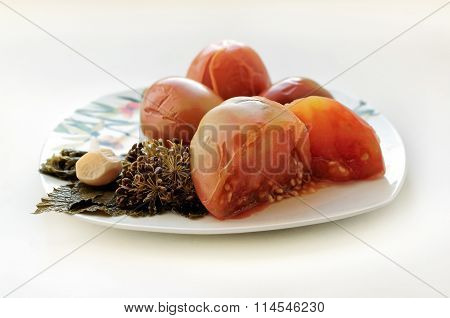 Pickled Tomatoes With Leaves Of Currant And Dill On A Plate