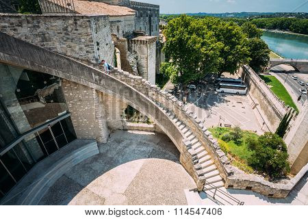 Man climbs the stairs to the walls of the fortress near the Pope