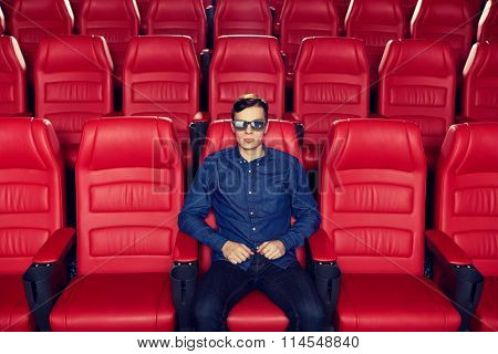 young man watching movie in 3d theater