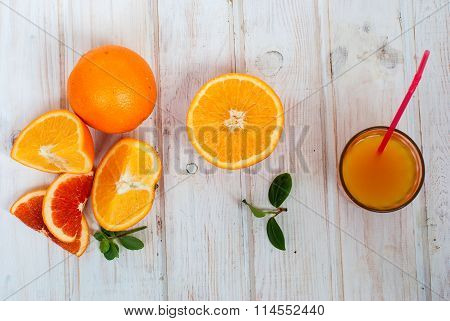 Glass Of Orange Juice And A Group Of Oranges On White Board Yable