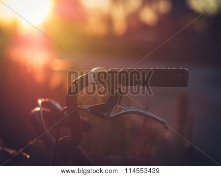 Aged Old Bicycle Handlebar in Backlight
