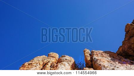 The rocky landscape on the beach under a clear blue sky